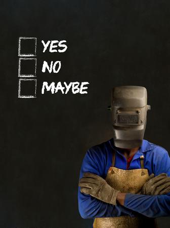 African black man industrial worker with chalk checklist on blackboard background photo