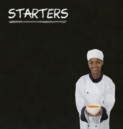 Chef with chalk starters sign written on blackboard background photo