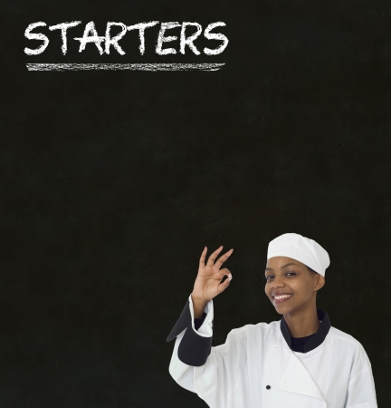 organic peppers sign: Chef with chalk starters sign written on blackboard background