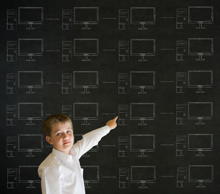 Pointing boy with chalk networks on blackboard background photo