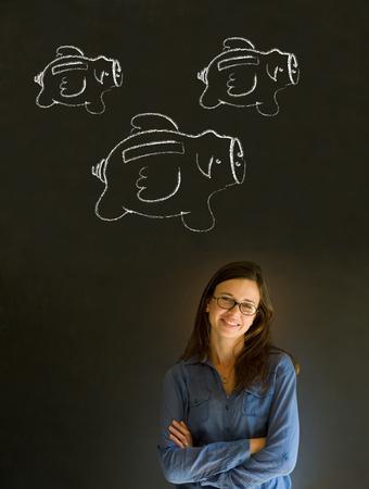Businesswoman, student or teacher with chalk piggie banks  concept blackboard background photo