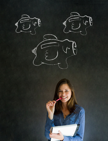 Businesswoman, student or teacher with chalk piggie banks  concept blackboard background photo