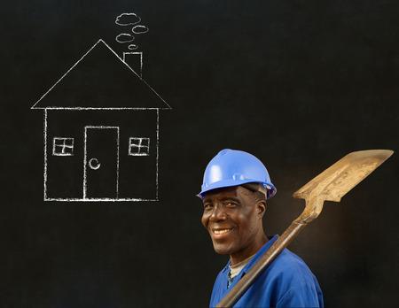 protection plan: African American black man worker with chalk house on a blackboard background Stock Photo