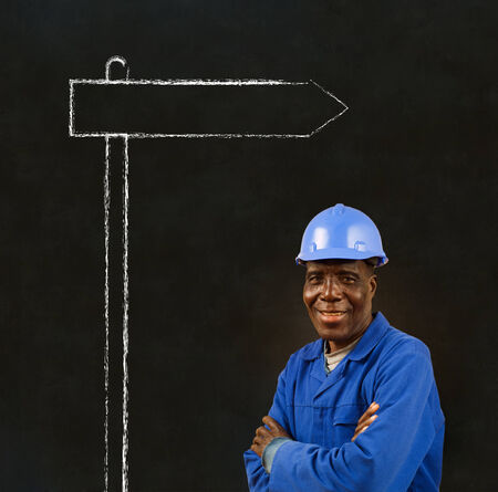 African American black man worker with chalk sign on a blackboard background photo