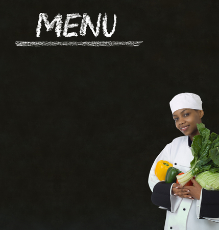 organic peppers sign: Chef with chalk menu sign written on blackboard background Stock Photo
