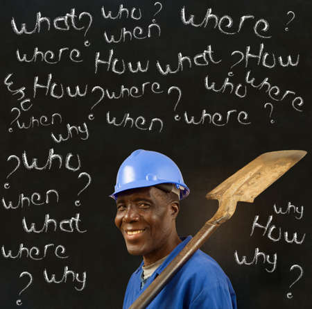 when: African American black man worker with chalk questions on a blackboard background Stock Photo