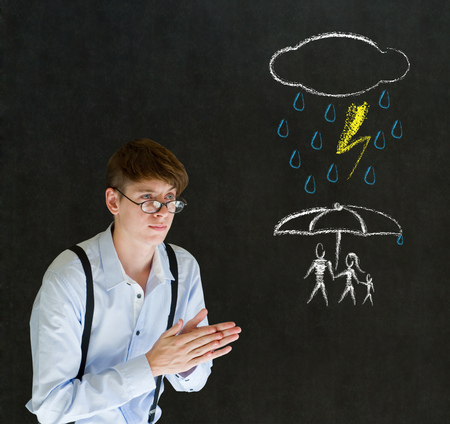 Insurance businessman protecting family from natural disaster on blackboard background photo