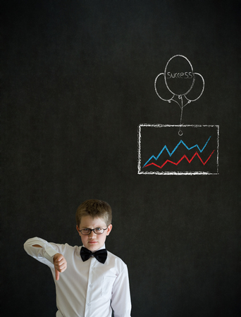 Thumbs down boy dressed up as business man with chalk success graph and balloon on blackboard background photo