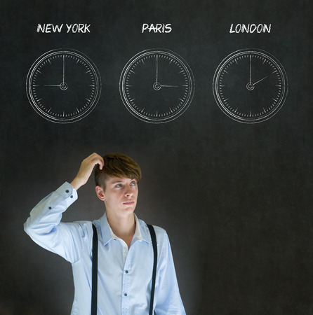 Businessman thinking with New York Paris and London chalk time zone clocks on blackboard background photo