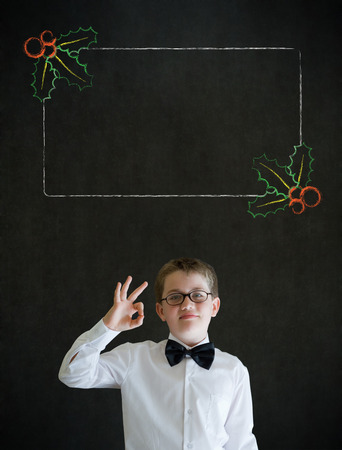 all ok: All ok boy business man with Christmas holly checklist Stock Photo