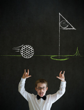 Knowledge rocks boy dressed up as business man with chalk golf ball flag green on blackboard background photo