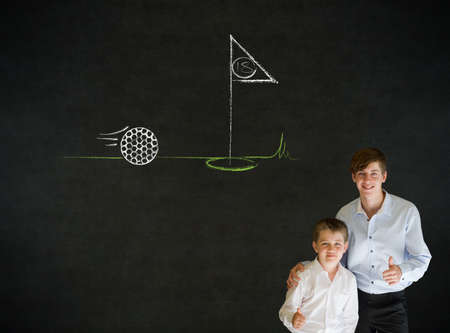 Thumbs up boy dressed up as business man with teacher man and chalk golf ball flag green on blackboard background photo
