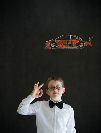 all ok: All ok or okay sign boy dressed up as business man with American racing fan car on blackboard background