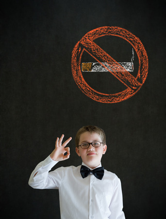 all ok: All ok or okay sign boy dressed up as business man with no smoking chalk sign on blackboard background Stock Photo