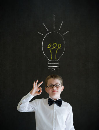 all ok: All ok boy dressed as business man with bright idea gear cog lightbulb Stock Photo