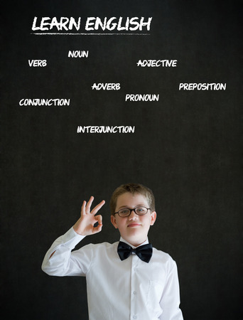all ok: All ok or okay sign boy dressed up as business man with learn English on blackboard background