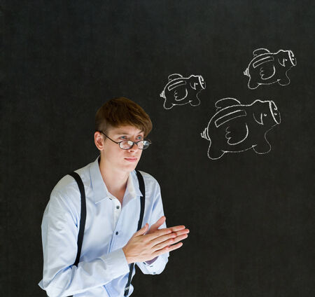 Businessman planning with flying money piggy banks in chalk on blackboard background photo
