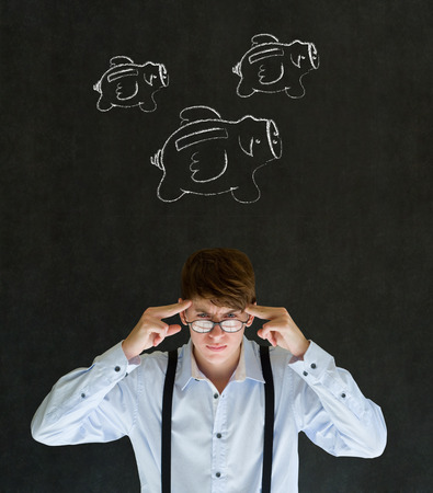 Thinking businessman with flying money piggy banks in chalk on blackboard background photo