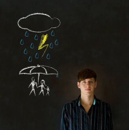 Man or Teacher thinking about protecting family from natural disaster on blackboard background photo