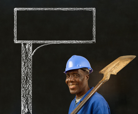 road worker: African American black man worker with a chalk road advertising sign on a blackboard background