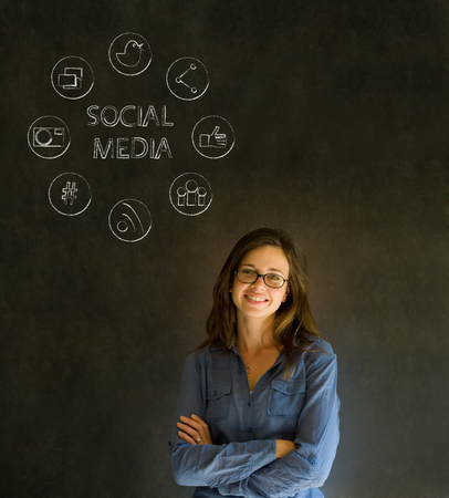Business woman or teacher with social media icons chalk blackboard background photo