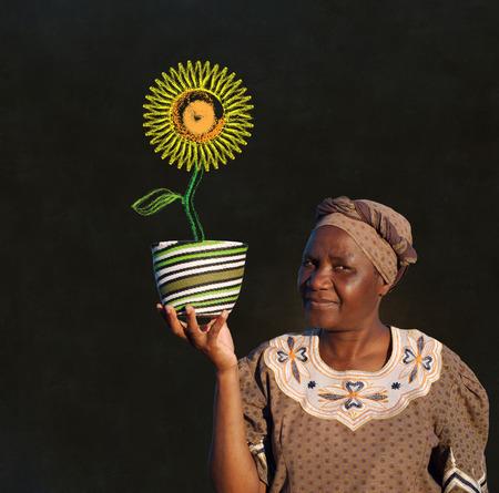 South African Zulu woman basket sales woman blackboard sunflower photo