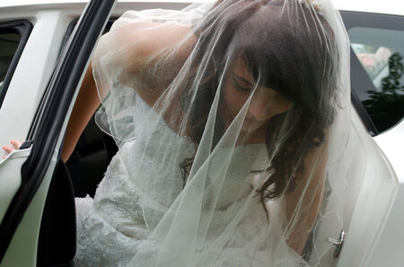 south african: Beautiful South African bride leaving car on way to wedding Stock Photo