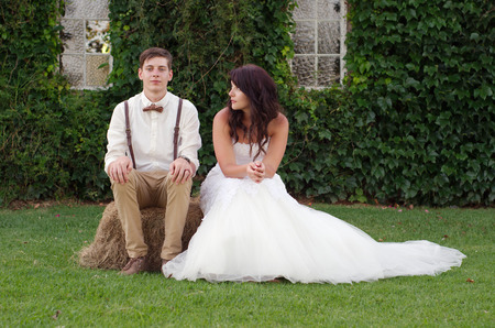 Hillbilly hipster vintage style bride and groom outside church after wedding ceremony photo