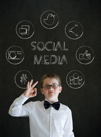 all ok: All ok or okay sign boy dressed up as business man with social media icons on blackboard background