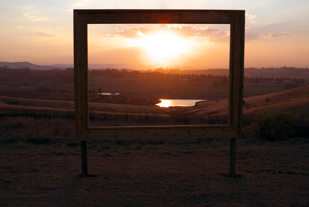 outdoor advertising: Sales sign frames African sunset