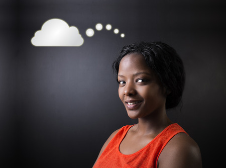 thought clouds: South African or African American woman teacher or student thinking with thought clouds