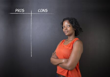 South African or African American woman teacher or student thinking pros and cons decision list chalk concept blackboard background photo