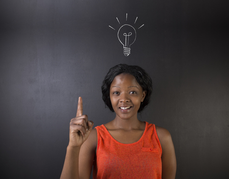 bulk memory: Bright idea chalk background lightbulb thinking South African or African American woman teacher or student on a blackboard