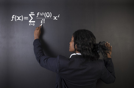 Learn maths, science or chemistry formula confident beautiful South African or African American woman teacher or student chalk blackboard background