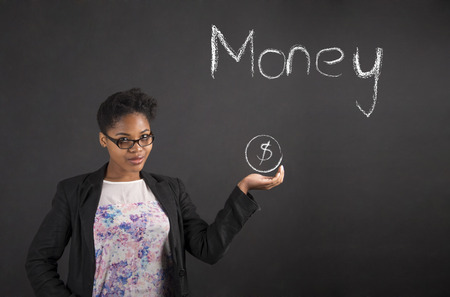 hand with money: South African or African American black woman teacher or student holding her hand out to the side showing money standing against a chalk blackboard background inside