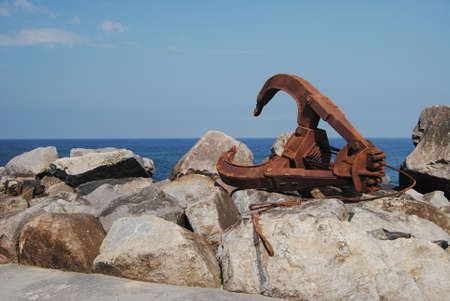 Crane accessory by the sea - orange peel claws - old trident with rust