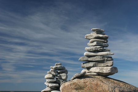 Stone stacks against the clear sky