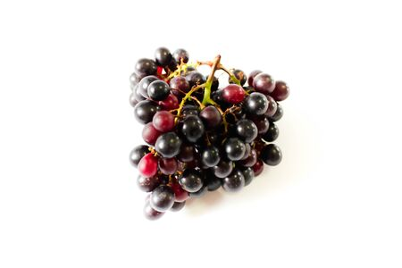 Black seedless grapes nontoxic for healthy on white background