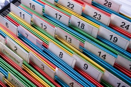 Documents folders sorted for archive with colors and numbers