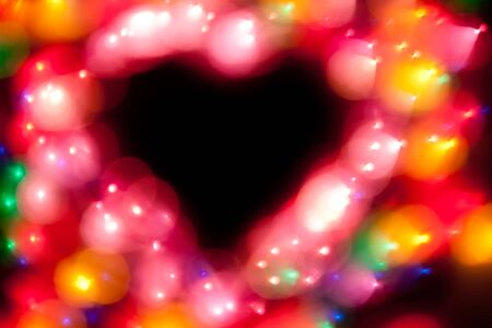 Beautiful colorful defocused glitter lights in heart shape. No focus! Stock Photo - 11931570