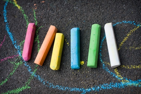 schoolyard: Colored chalk on playground with drawings on street
