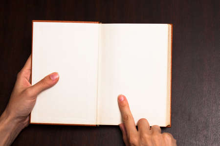Finger pointing on paper Stock Photo - 14610319