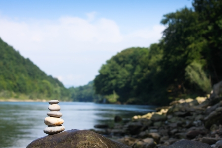 Teamwork balance concept  Balance stone on river coast Stock Photo