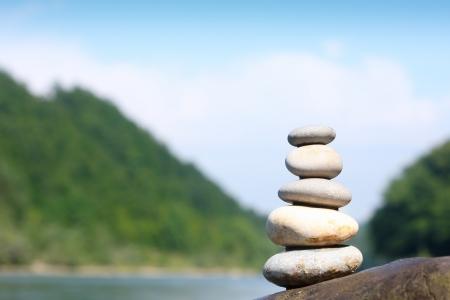 Teamwork balance concept  Balance stone on river coast Stock Photo