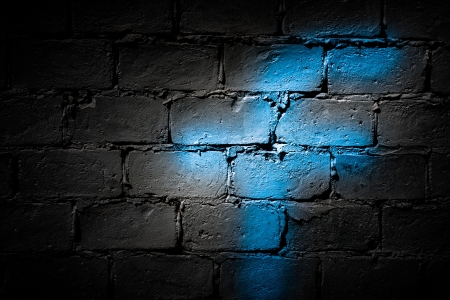 Blue letter F on a dark wall photo