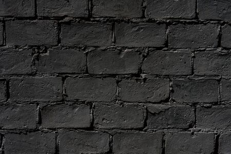 Dark brick wall, empty with copy space