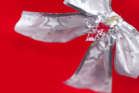 White bow on red background   Stock Photo