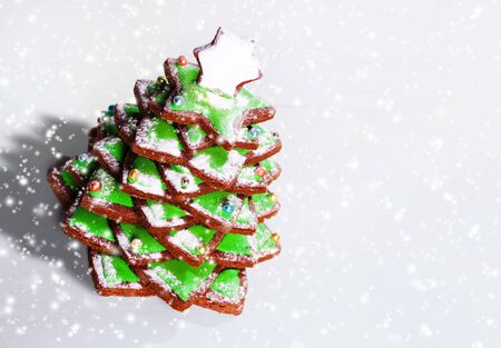 Gingerbread cookies stacked as christmas tree