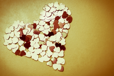 as one: Group of hearts arranged as one hear in retro look   Stock Photo