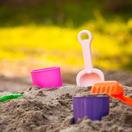 Child playground of sand with beach toys